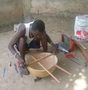 kora maker lining up the cross bar and handles